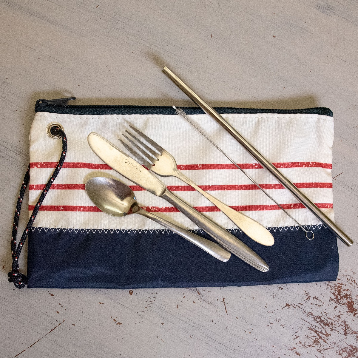 reuseable sea bag wristlet with reusable utensils