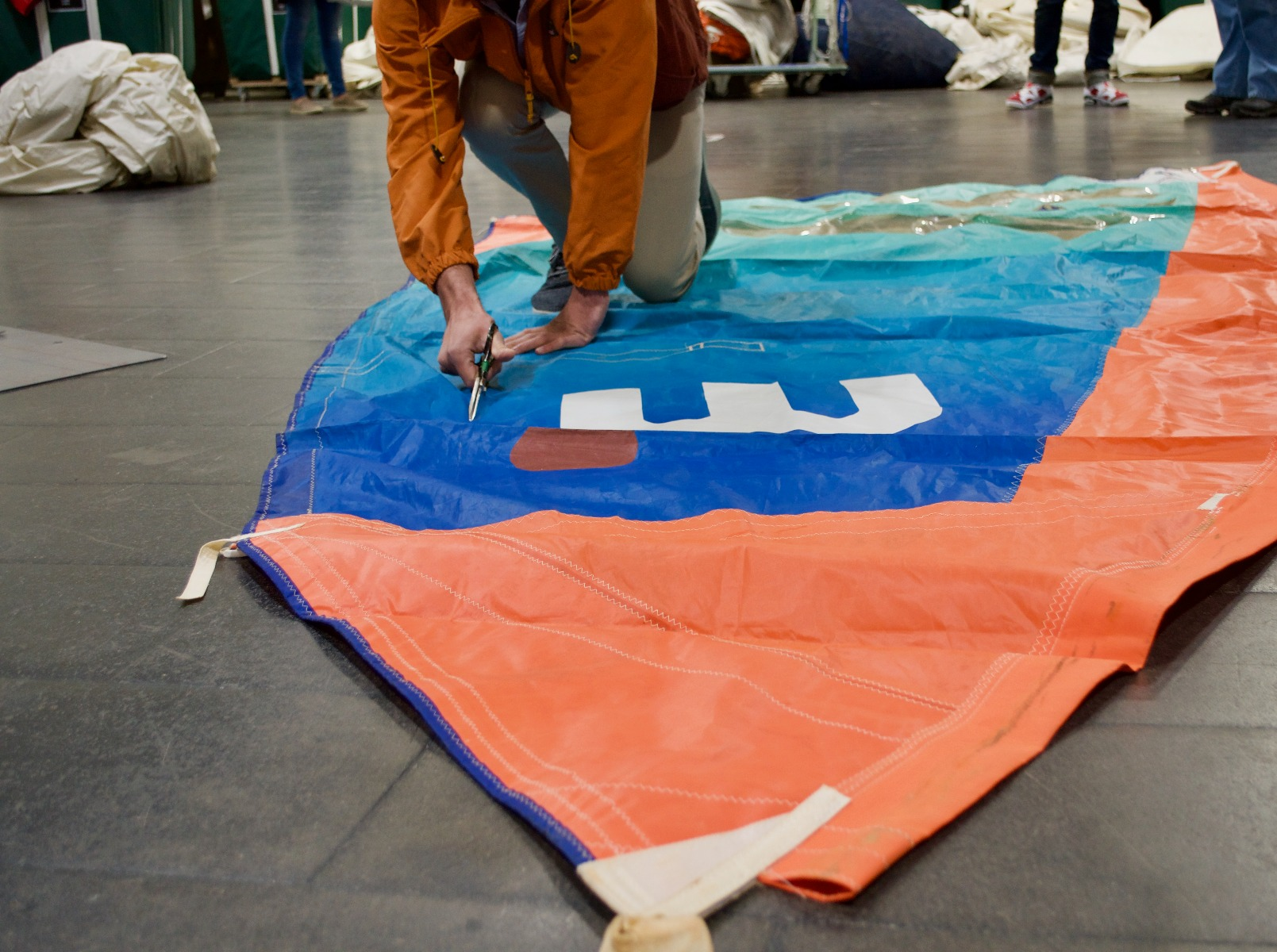 Windsurfer Sail Being cut Before Becoming A Recycled Sea Bag
