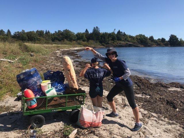 4ocean beach cleanup on beach in maine
