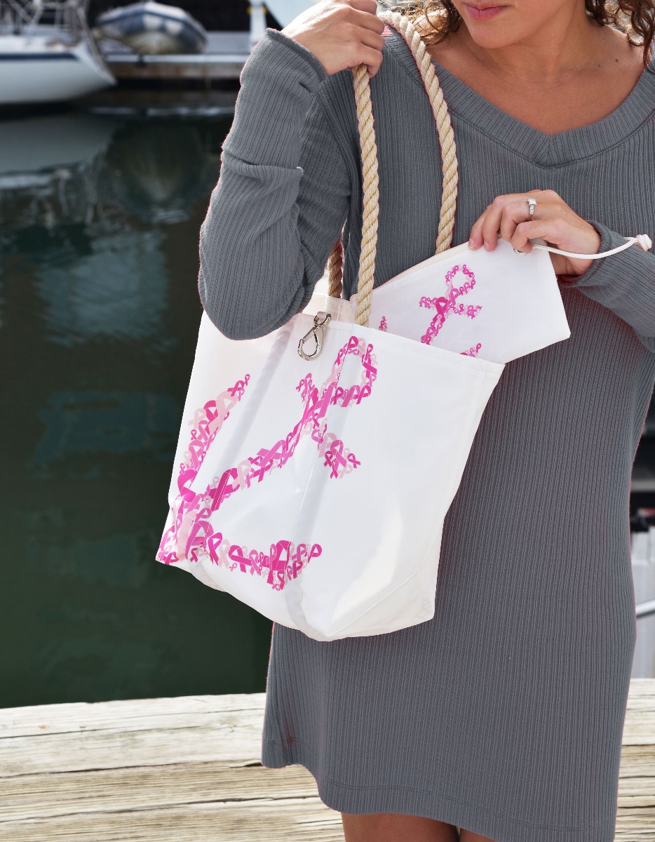 The limited-edition handbag and wristlet feature an anchor comprised of Breast Cancer Awareness ribbons