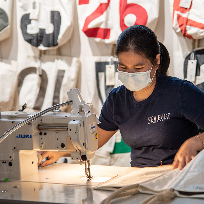 Sea Bags seamstress doing a stitching demo at our new flagship store