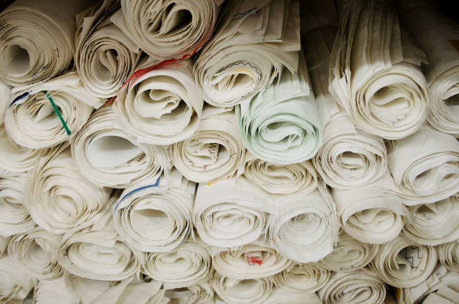 Rolled panels of recycled sail cloth for making totes and accessories