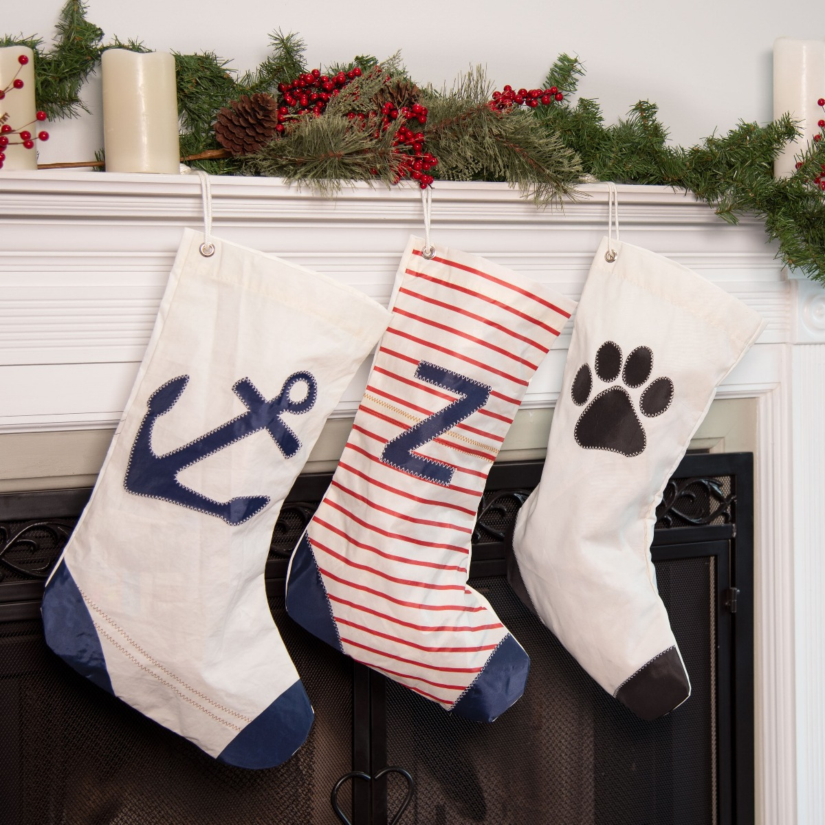 sustainable sail cloth stockings hanging from mantel