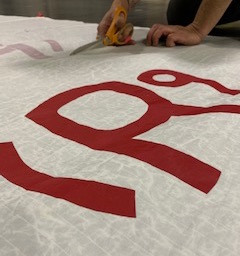 Sail cloth is carefully cut by hand at the Sea Bags warehouse