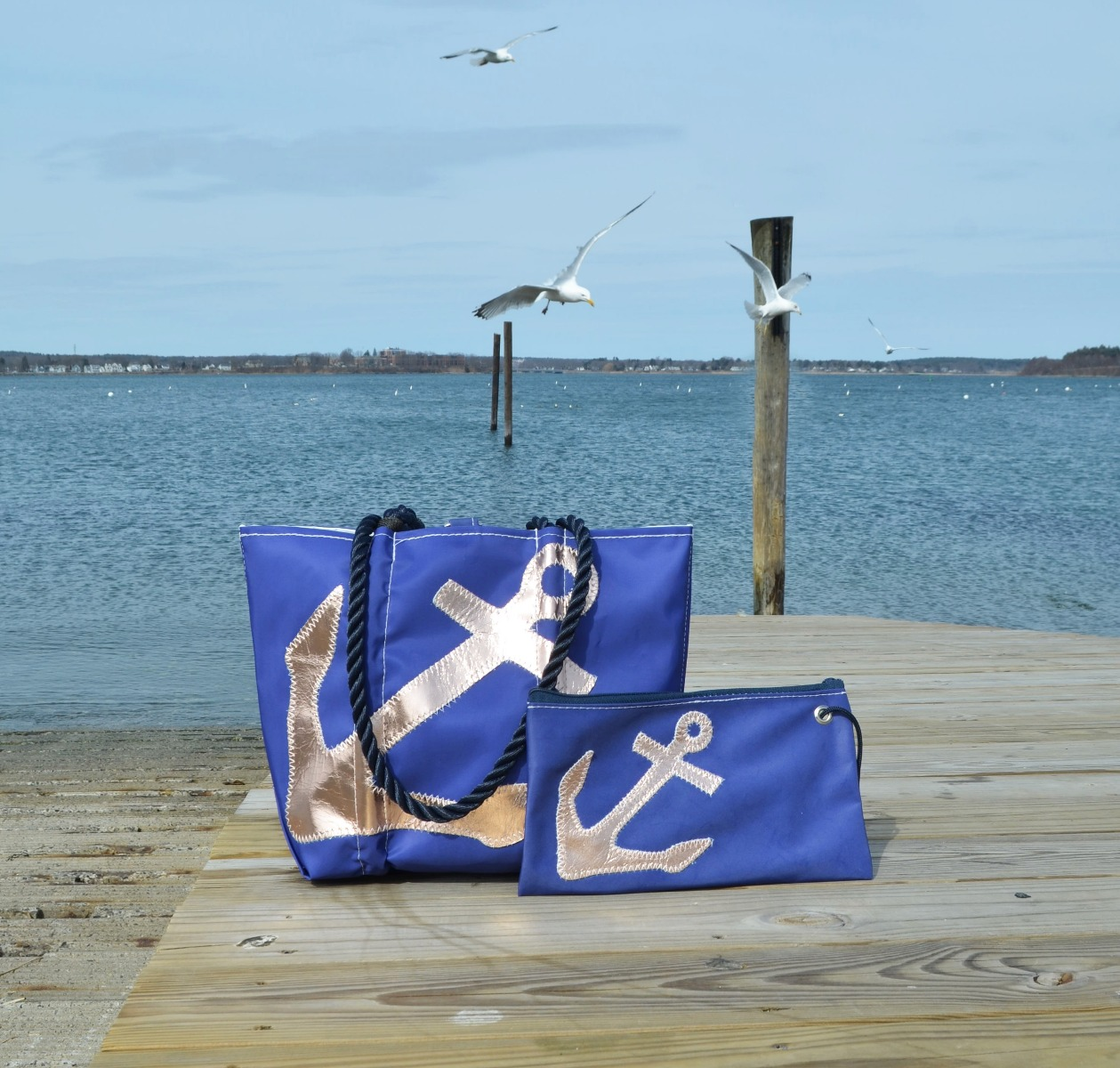 Rose Gold-on-Navy Anchor Collection made from recycled sail cloth