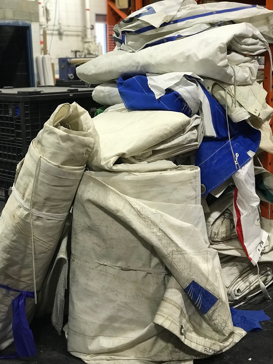 Pile of used sails in the warehouse