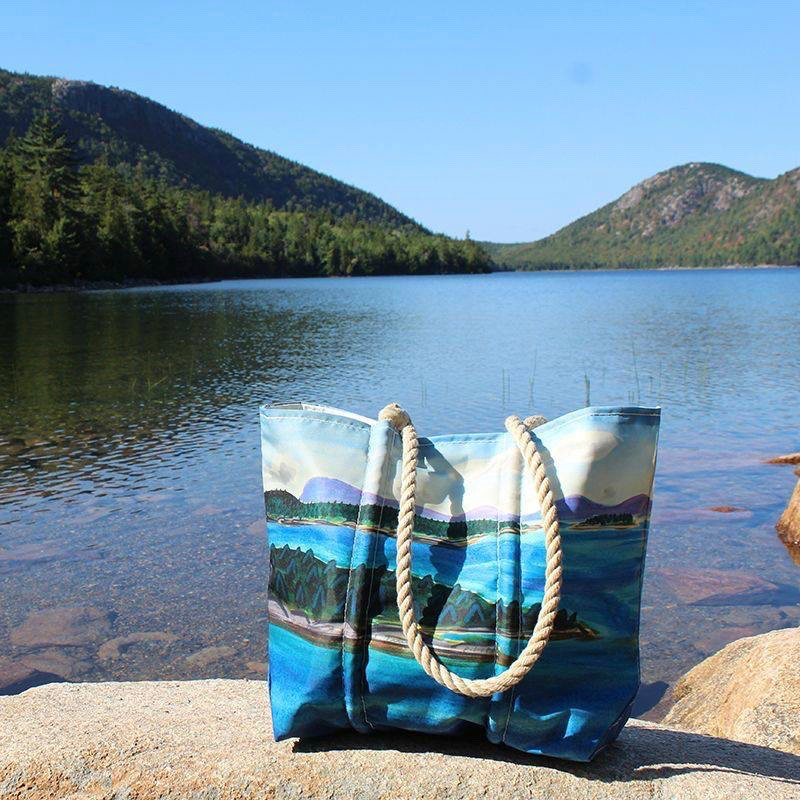 Eric Hopkin's Watercolor Tote depicts the coastline of Maine on recycled sail