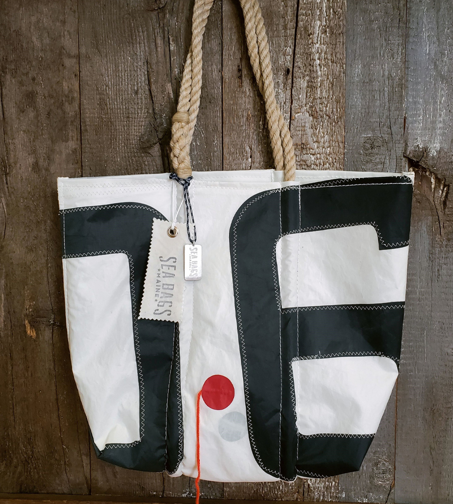 A Vintage Insignia tote featuring a telltale on the front of the bag