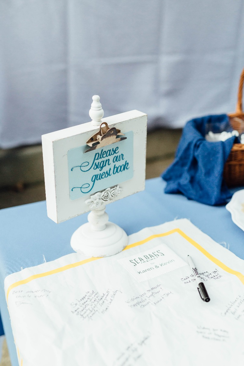 A unique idea for a guest book, Sea Bags' recycled sail cloth panel is displayed at the event for guests to sign