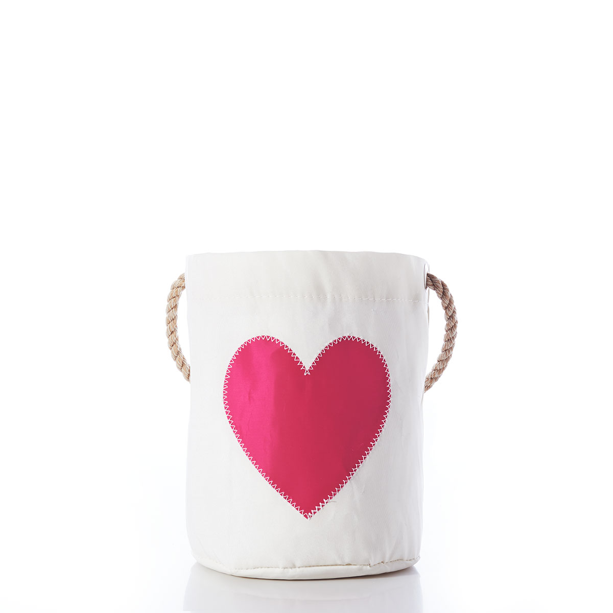 a white recycled sail cloth bucket with a white rope handle is embellished with a fuchsia pink heart