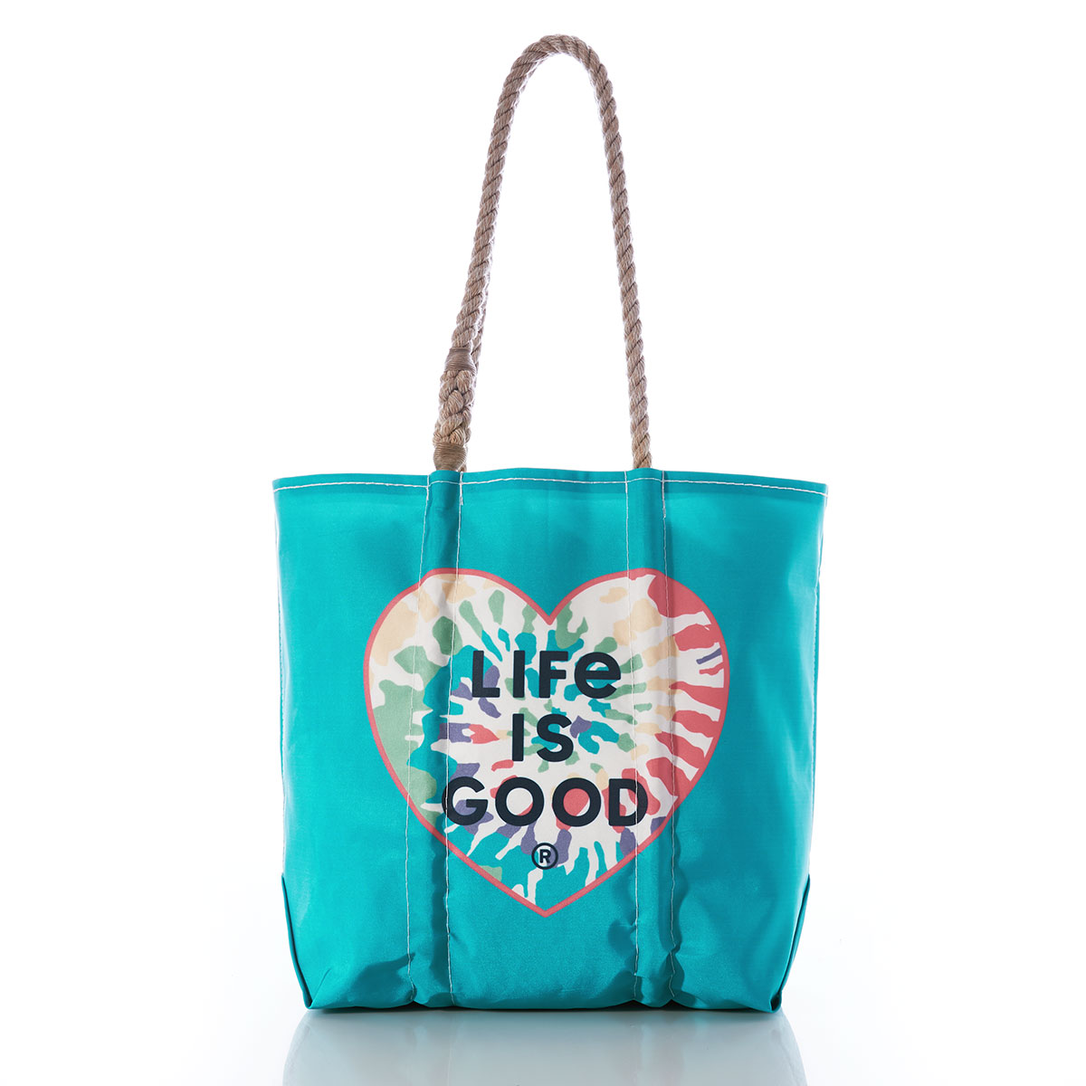 a teal blue recycled sail cloth tote with hemp rope handles is printed with a tie dye heart shape with the life is good brand name inside