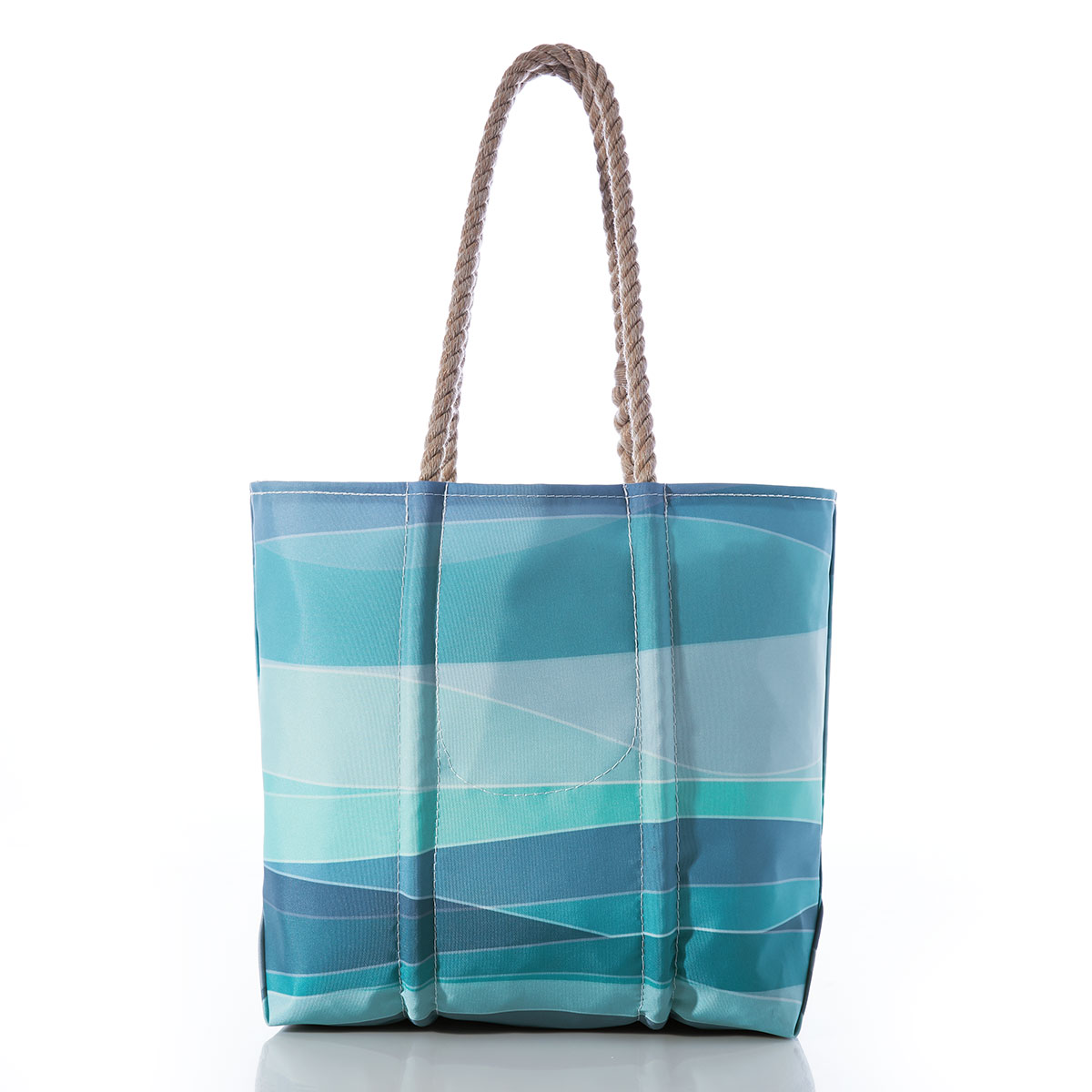 back of sail cloth tote bag, asymmetrical stripes in shades of blue and teal, and a hemp rope handle