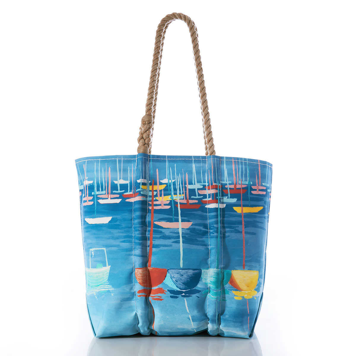 colorful sailboats bob in a blue ocean on a recycled sail cloth tote with hemp rope handles