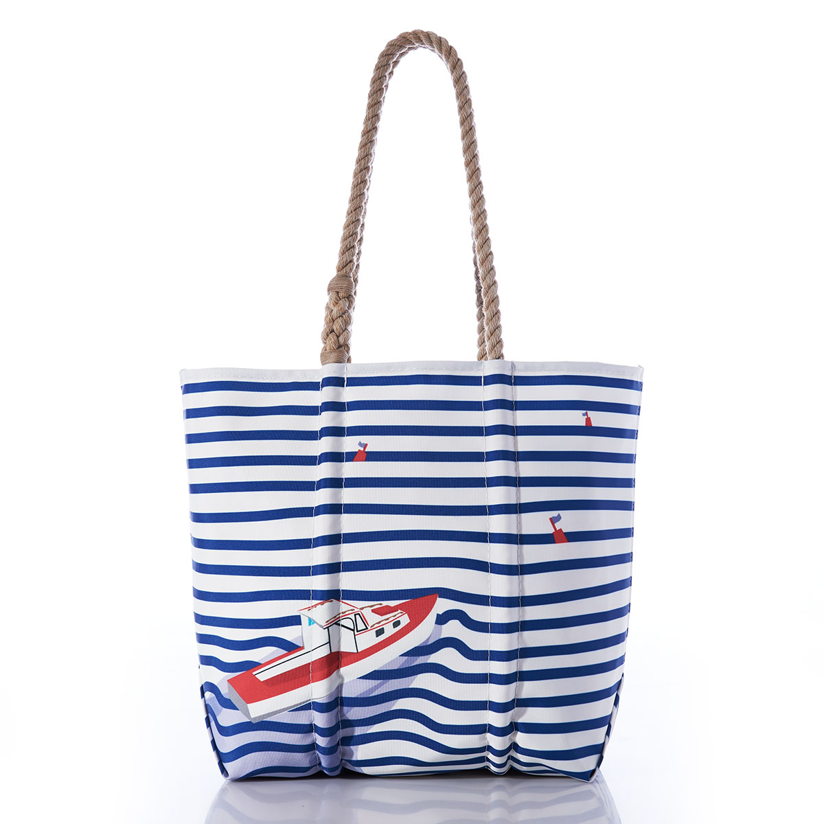 front of tote bag with stripes of royal blue and white, broken by the movement of a red and white lobster boat as it heads between two red buoys bobbing between the stripes, and a hemp rope handle