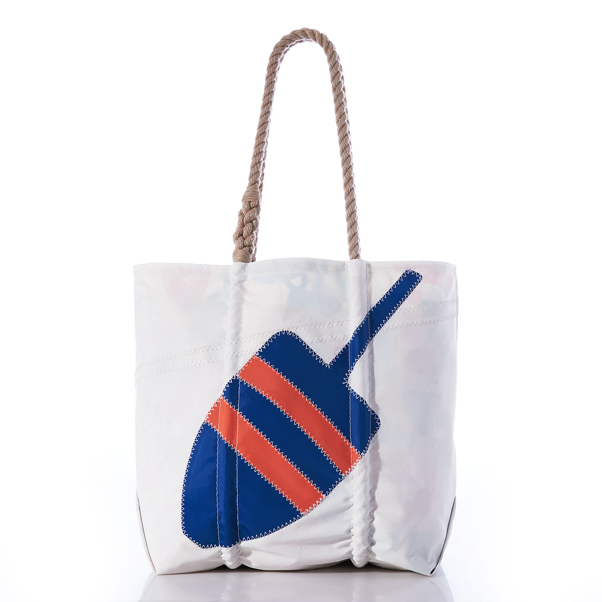 blue and orange striped buoy sits diagonally on a white recycled sail cloth tote with hemp rope handles