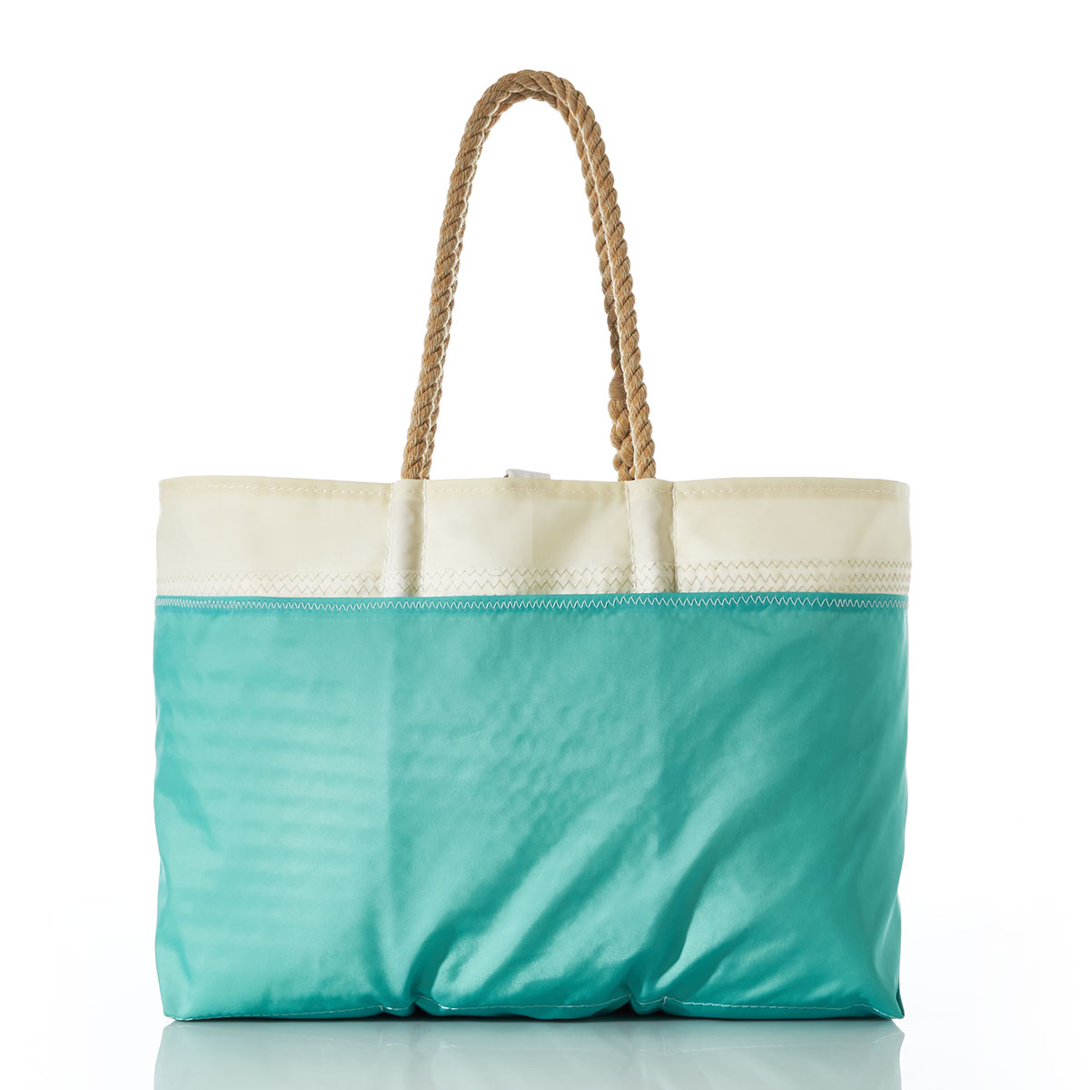 back view showing seafoam green outer pocket, stripes of shades of blues are printed on this recycled sail cloth tote, with a seafoam green bottom and hemp rope handles