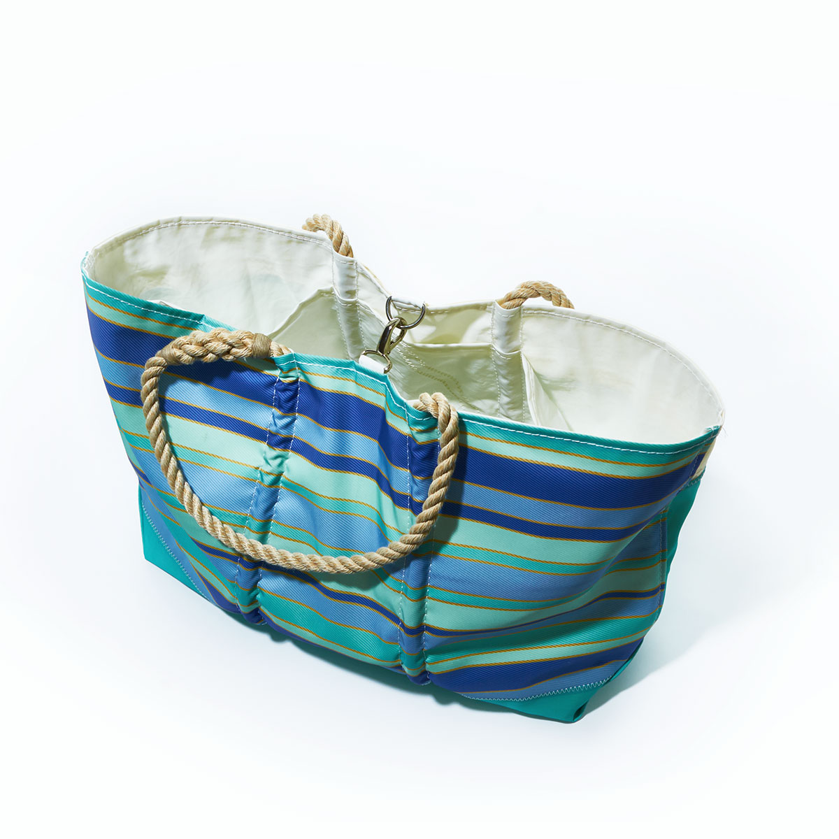 clasp closure, stripes of shades of blues are printed on this recycled sail cloth tote, with a seafoam green bottom and hemp rope handles